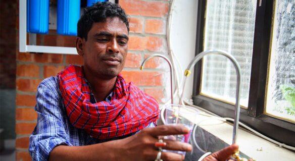 Man using a public toilet in Dhaka