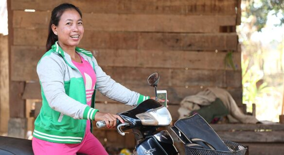 Woman on motorbike in Cambodia