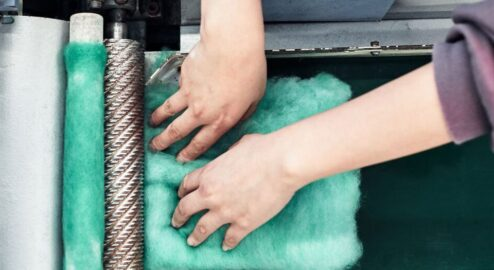 Shredding the garment in the Garment-2-Garment recycling system.