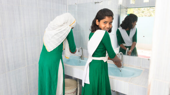 Girl in Bangladesh washing her hands