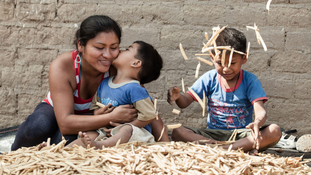 Mother with her two children, Peru