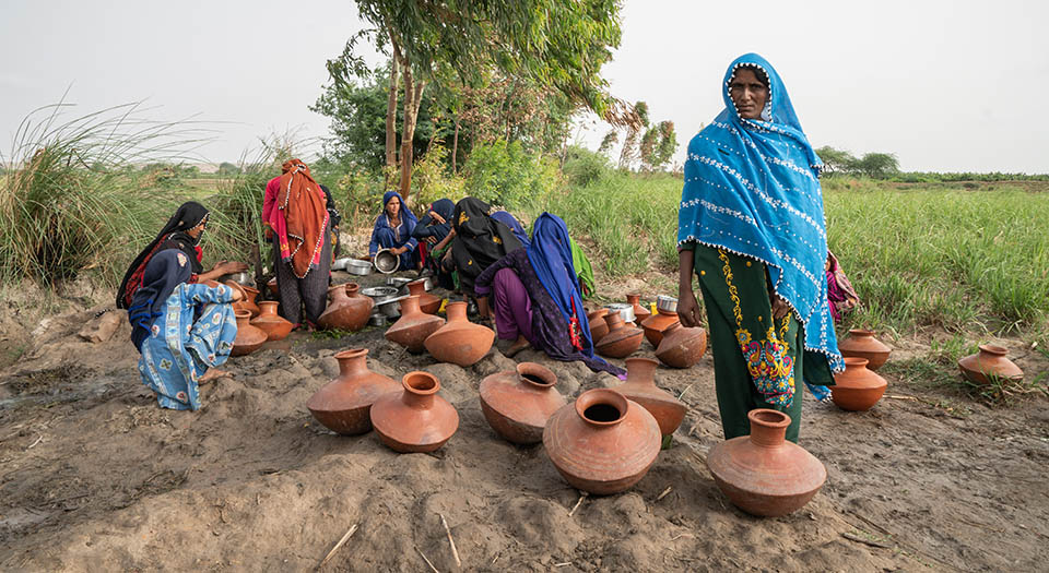 Noor Bano, 45, waiting for her turn to collect water at a distant water point near the village of Siddique Shoro in the Thatta District, Province Sindh, Pakistan.