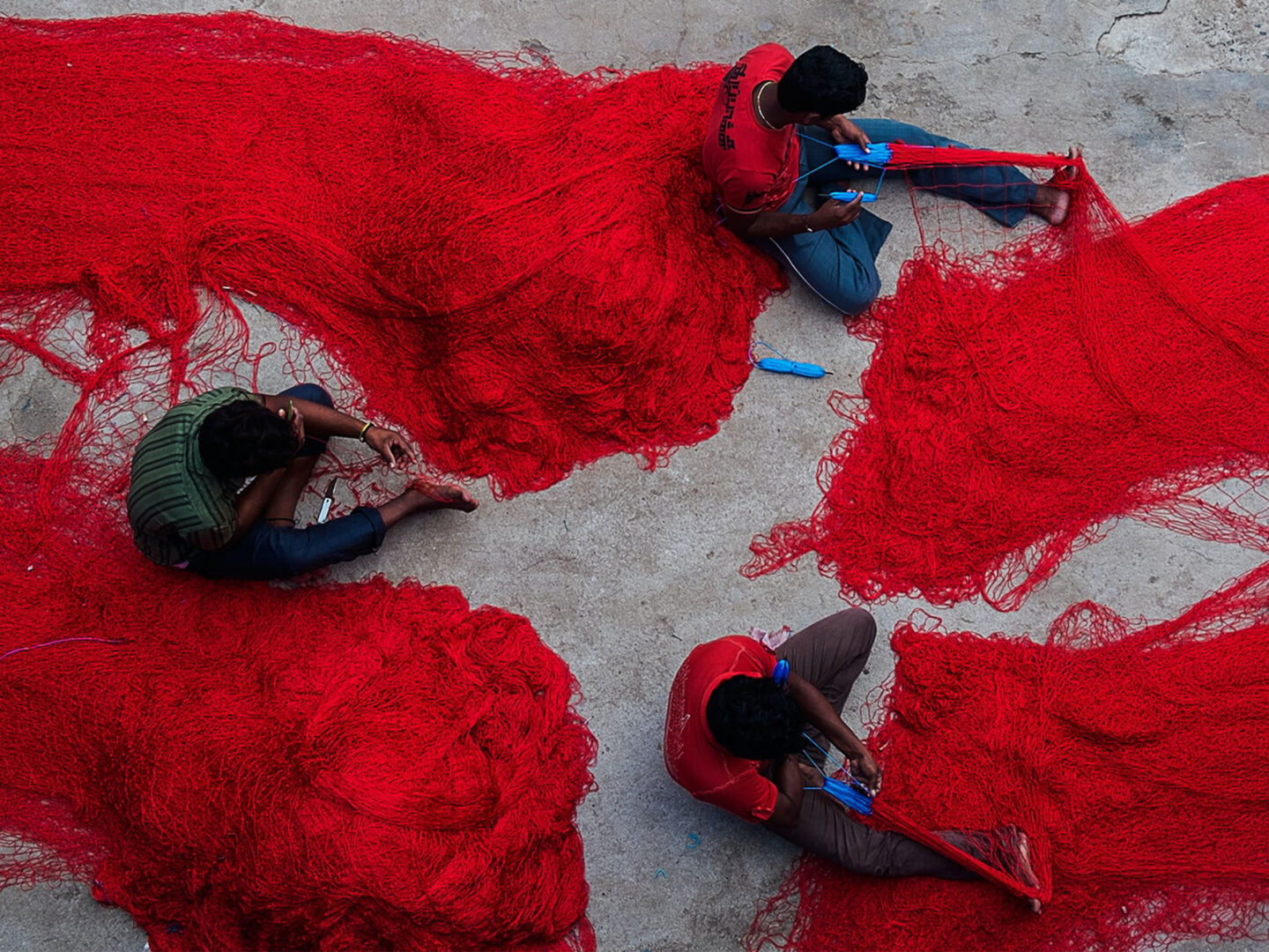 Men working with fishing nets.